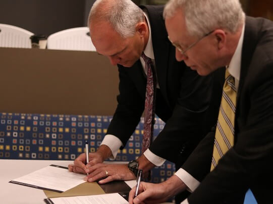 "President Ohles and President Illich make the SCC to NWU Pathways Scholarship Program official. ""We are delighted to partner with Southeast Community College to open more doors to bachelor degree completion,"" said President Ohles."