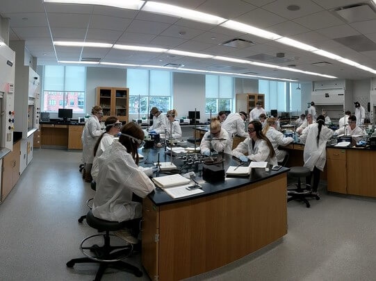 Chemistry students use a lab for the first time in Acklie Hall.